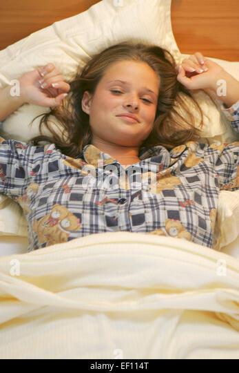 Relexation woman stock photos relexation woman stock for Bett schlafen