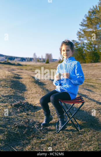 Girl Sitting On Stool Stock Photos Amp Girl Sitting On Stool