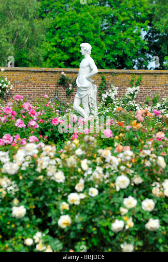 English Rose Garden With Classical Statues   Stock Image
