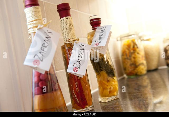 Ornate Decorative Storage Bottles And Jars On A Kitchen Work Surface Stock Image