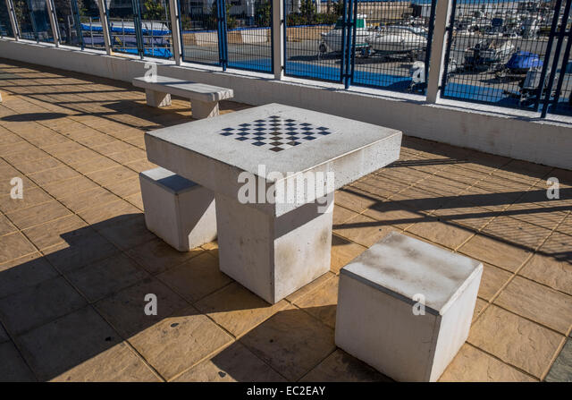 Good An Outside Stone Chess Table With Stone Seats For Two People   Stock Image