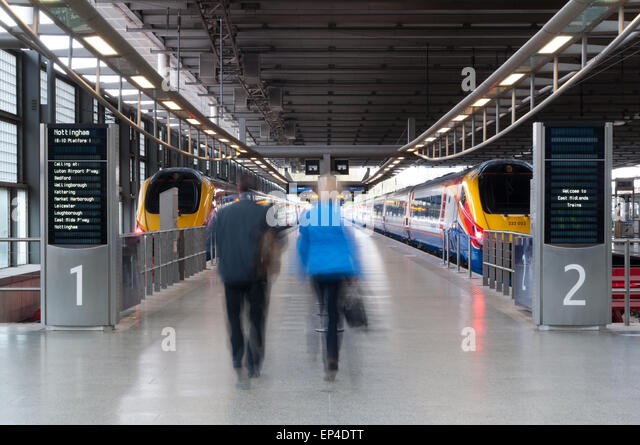 passengers-getting-on-the-train-at-the-s
