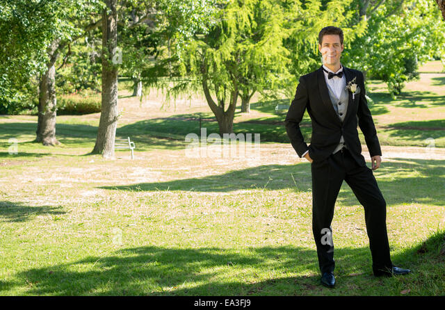 Pleasant Bridegroom Standing Stock Photos  Bridegroom Standing Stock  With Inspiring Confident Groom Standing In Garden  Stock Image With Enchanting Heavy Duty Garden Bench Also Vtech In The Night Garden Book In Addition Maze Rattan Garden Furniture And Goodnestone Park Gardens As Well As Swedish Bakery Covent Garden Additionally Holiday Inn Express Madison Square Garden From Alamycom With   Inspiring Bridegroom Standing Stock Photos  Bridegroom Standing Stock  With Enchanting Confident Groom Standing In Garden  Stock Image And Pleasant Heavy Duty Garden Bench Also Vtech In The Night Garden Book In Addition Maze Rattan Garden Furniture From Alamycom