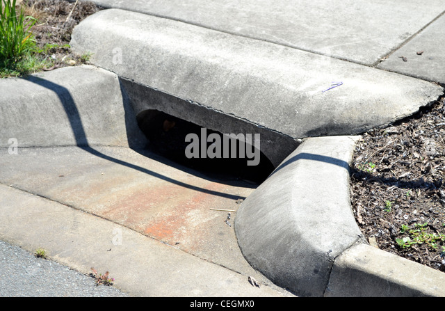 Concrete Storm Sewer : Water drain stock photos images alamy