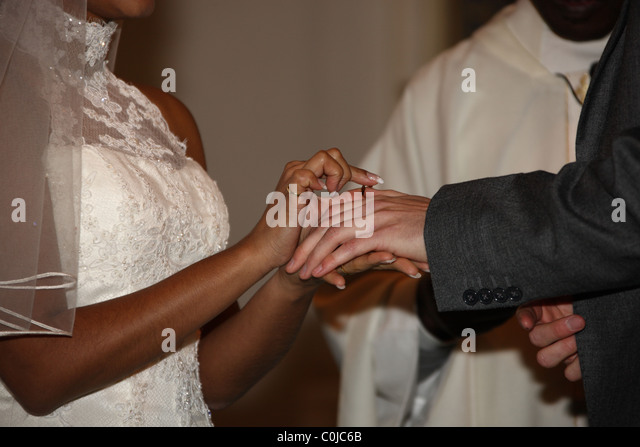 The Exchange Of Rings During A Roman Catholic Church Wedding Ceremony An Asian Bride With