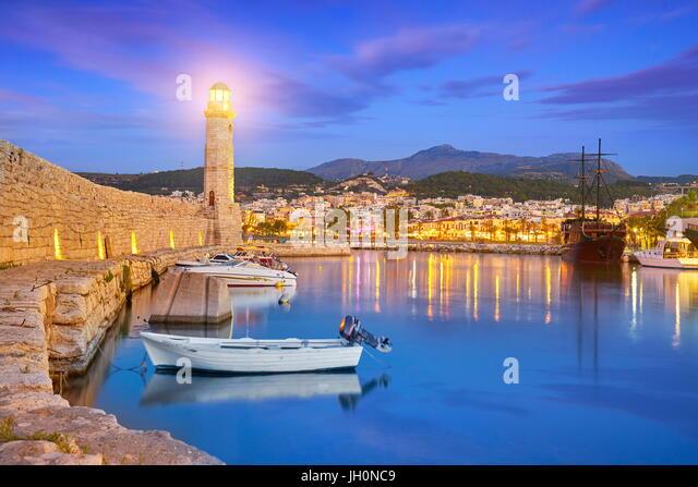 Crete Island - Lighthouse at Old Venetian Port, Rethymno, Greece - Stock Image
