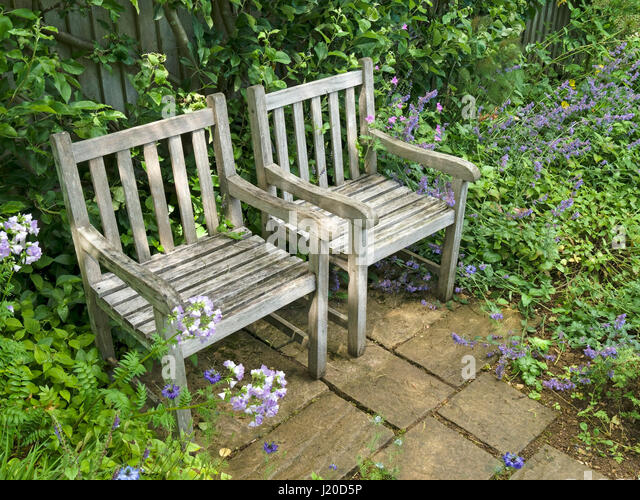 Row of two wooden garden chairs on small slabbed patio  Barnsdale Gardens   Oakham. Wooden Garden Chairs Stock Photos   Wooden Garden Chairs Stock