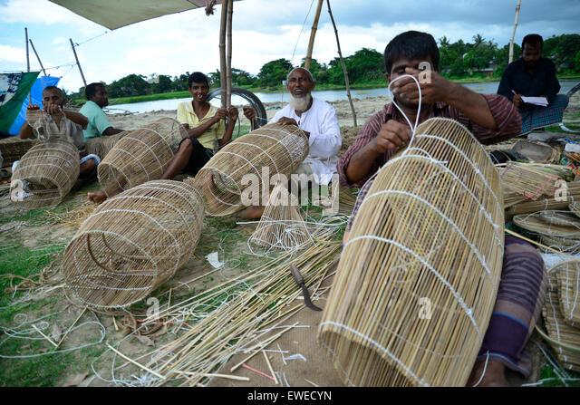 Bamboo Stcik People ~ Man making baskets stock photos