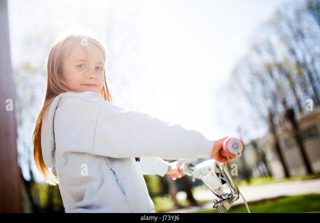 Photo of girl with bicycle - Stock Image
