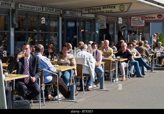 Beautiful Hamburg Riverside Restaurant Patio, People Drinking Beer On A Sunny Day    Stock Image