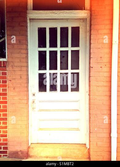 White Door, Peach Brick   Stock Image