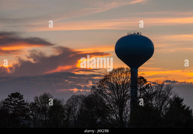 Water Tower Silhouetted in the Evening Sky - Stock Image