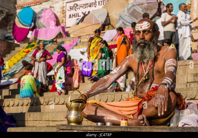 Portrait of a Sadhu, holy man, sitting on a platform at the holy river Ganges at Dashashwamedh Ghat, Main Ghat, - Stock Image