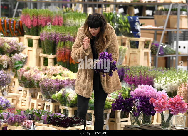 Pretty New Covent Garden Market Stock Photos  New Covent Garden Market  With Excellent Editorial Use Only A Customer Inspects Blooms On The Opening Day Of The New  Flower Market With Lovely Crown Gardens Brighton Also Garden Furniture For Sale On Ebay In Addition Outdoor Garden Sphere And Telegraph Gardening Offers As Well As Maddison Sqaure Garden Additionally Rosewood Covent Garden From Alamycom With   Excellent New Covent Garden Market Stock Photos  New Covent Garden Market  With Lovely Editorial Use Only A Customer Inspects Blooms On The Opening Day Of The New  Flower Market And Pretty Crown Gardens Brighton Also Garden Furniture For Sale On Ebay In Addition Outdoor Garden Sphere From Alamycom