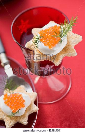 ... with crème fraîche and salmon caviar (Christmas) - Stock Image