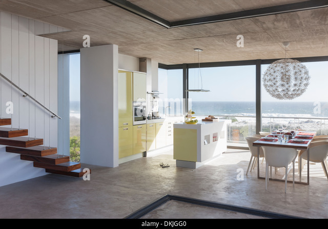 Modern Kitchen And Dining Room Overlooking Ocean
