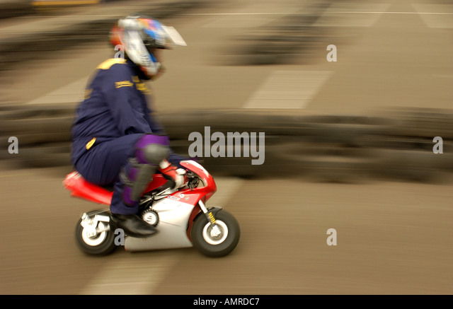 youth riding a mini moto stock image