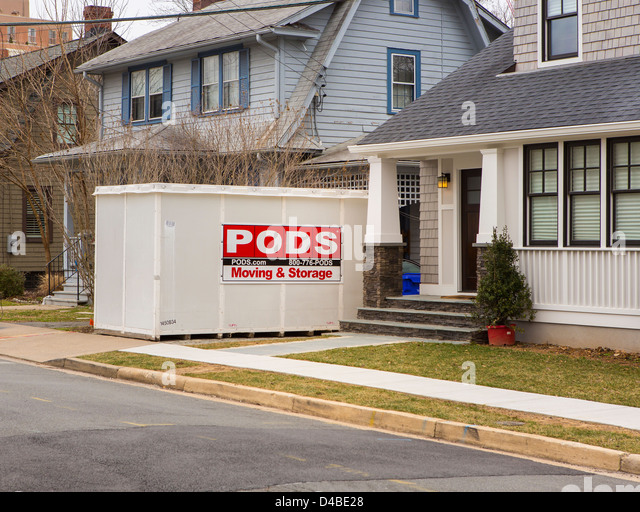 ARLINGTON, VIRGINIA, USA   PODS Storage Container In Front Of Houses.    Stock