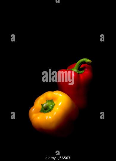 Sweet peppers on black. Dramatic studio shot. - Stock Image