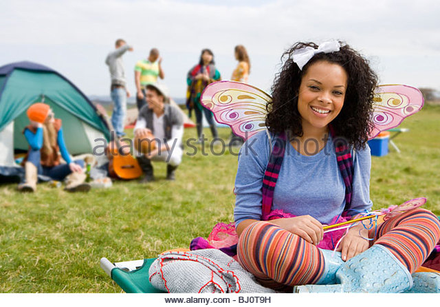 Teenage Girl In Fairy Costume Camping And Attending Outdoor Festival
