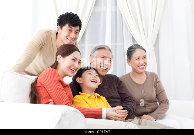 asian family watching television stock photos amp asian