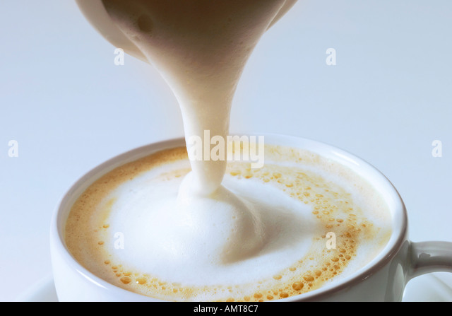 Pouring Cream Into Coffee Stock Photos & Pouring Cream ...