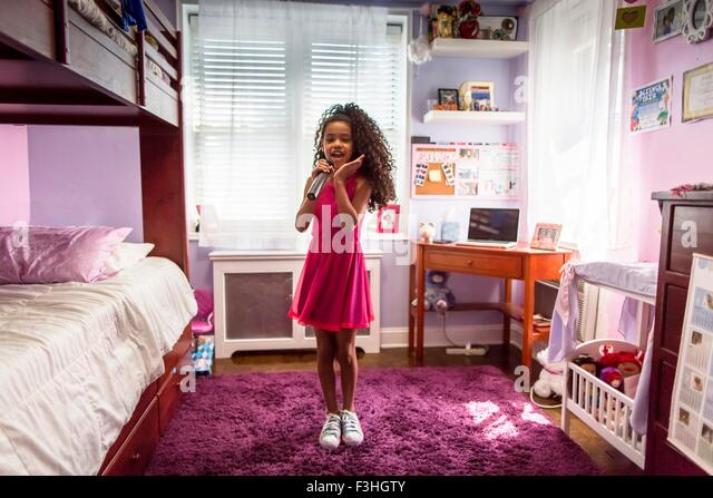 Girl in bedroom singing into microphone and dancing   Stock Image. Girl Dancing Bedroom Stock Photos   Girl Dancing Bedroom Stock