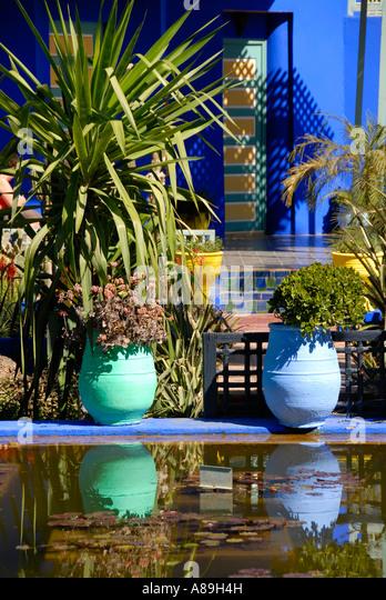 Shining Luminous Blue Of Flowerpots Mirrors In Water Garden Jardin  Majorelle Marrakech Morocco   Stock Image