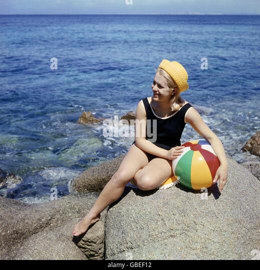 Sun Bathing 1960s Stock Photos & Sun Bathing 1960s Stock
