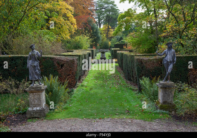 High Quality Pretty English Garden With Statues And Clipped Yew Hedging.   Stock Image