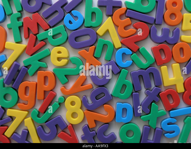 magnetic letters and numbers on a fridge stock image