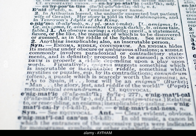 large hardback dictionary reference book stock photos large a close up selective focus on the definition of enigma stock image