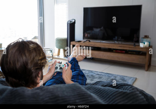Man Playing Video Games In Living Room