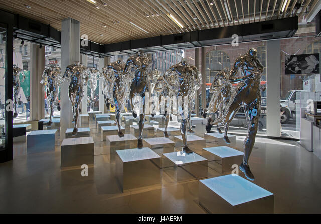 Chrome colored sculptures of headless runners at the Nike Store on Broadway  & Spring Street in