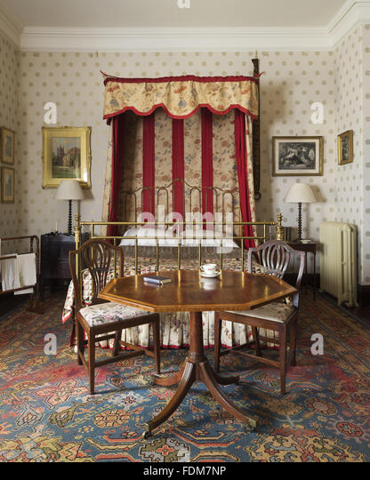 The East Quantoxhead Bedroom at Dunster Castle, Somerset, with iron and  brass bed with