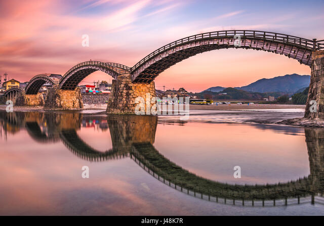 Iwakuni, Hiroshima, Japan at Kintaikyo Bridge at dusk. - Stock Image