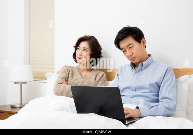 Asian couple in bedroom 6
