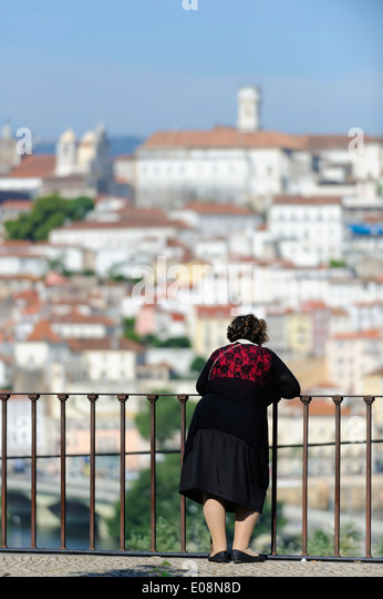 Coimbra portugal woman stock photos coimbra portugal for Balcony overlooking city