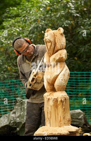 Bear wood carving stock photos