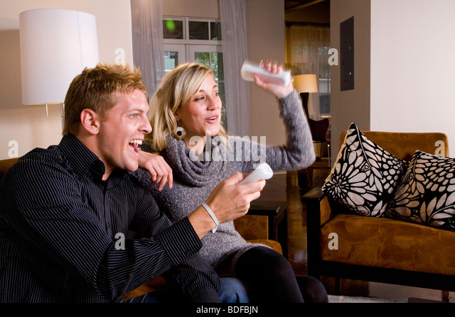 Friends playing video games stock photos friends playing for Living room ideas young couples
