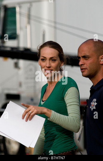 Extreme Home Makeover Designer Talks With Show Security Person Stock Image