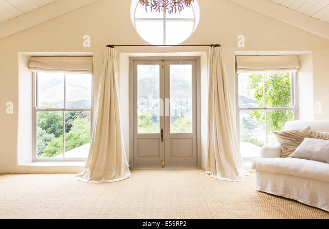 Curtains And Front Doors Of Rustic House   Stock Image