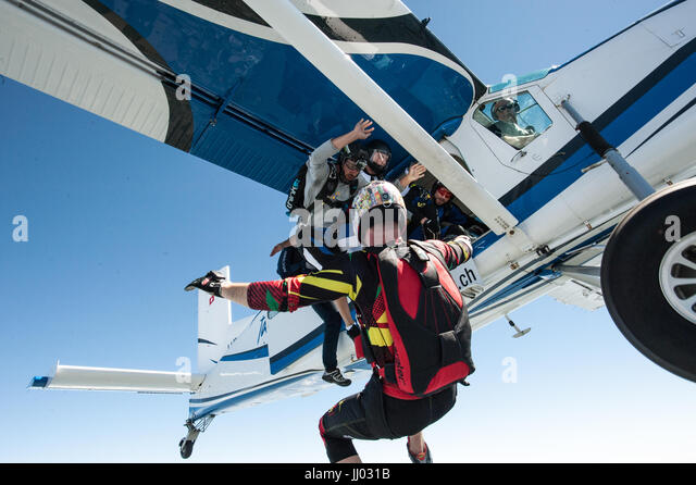 Skydivers Skydivers exiting a Pilatus Porter for a fun jump - Stock Image