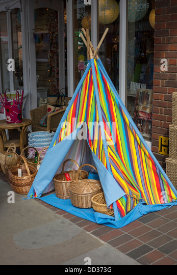A miniature striped and colourful tepee tent set up outside a shop and filled with wicker & Striped Tent Stock Photos u0026 Striped Tent Stock Images - Alamy