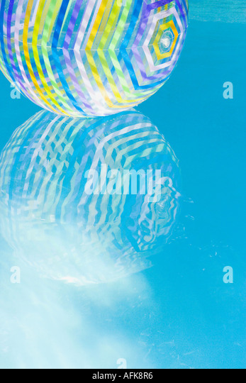 Pool Water With Beach Ball beach ball swimming pool stock photos & beach ball swimming pool