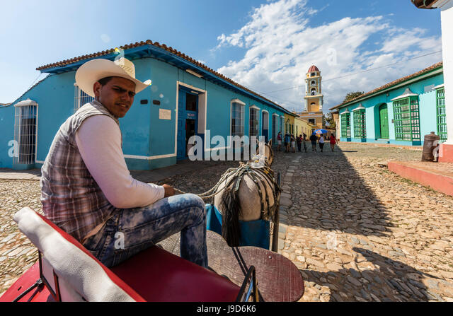 A horse-drawn cart known locally as a coche in Plaza Mayor, in the town of Trinidad, UNESCO, Cuba, West Indies, - Stock Image