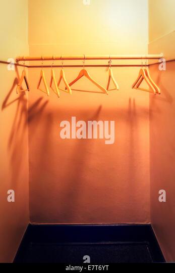 Empty Closet With Wooden Hangers