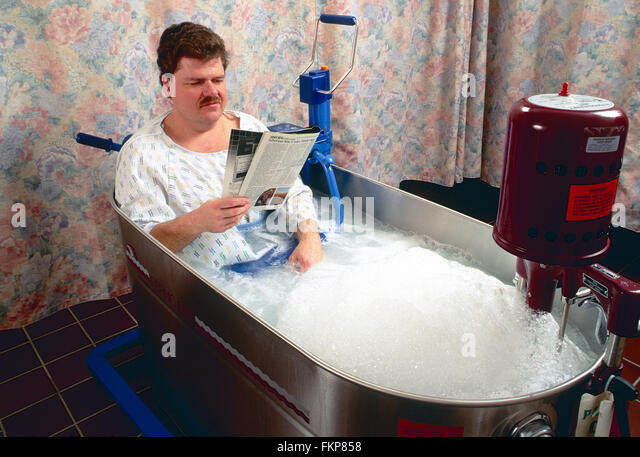 Male Patient In Whirlpool Tub For Physical Therapy   Stock Image