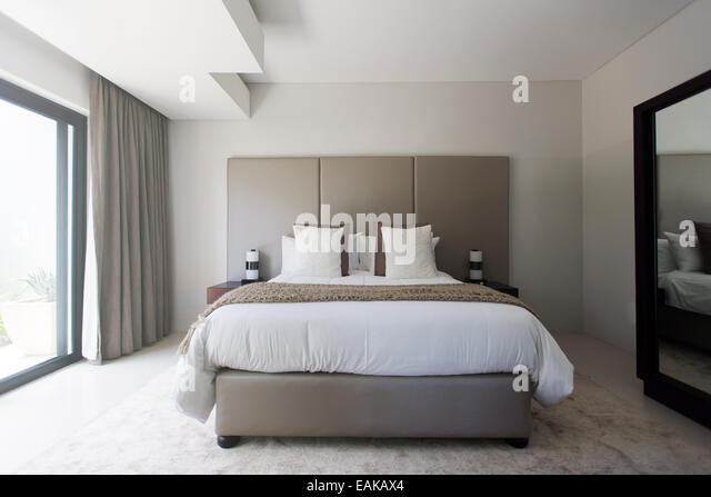Modern White And Beige Bedroom With Double Bed   Stock Image
