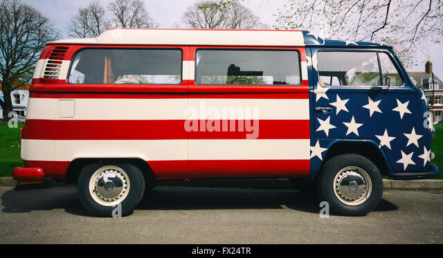 A Volkswagen Camper Van Painted In The Stars And Stripes Of American National Flag
